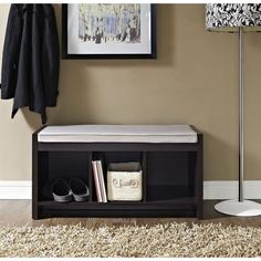 Add additional storage space in the entryway or foyer with this lovely wood bench, featuring 3 open cubbies.
