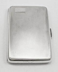Solid Silver Cigarette Case.  It is rectangular in shape and has a wavy engine turned pattern covering the front and back.  http://www.silver2treasure.com/sterling-silver/study-library-silver/silver-cigarette-cases/