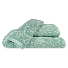 A dotted medallion motif set against an ice blue background on the French Perle Bath Towel Collection from Lenox makes for a vibrant and whimsical addition to a bathroom. Soft and plush, each cotton towel caresses your skin in softness.