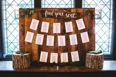 """A wooden """"Find Your Seat"""" guide for wedding guests, with beautiful table cards hung with mini clothespins in the Dining Room at Willowdale Estate, Topsfield Massachusetts willowdaleestate.com"""