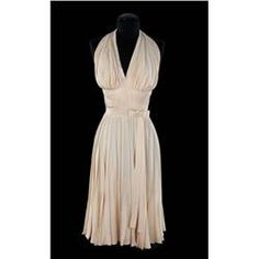 """Marilyn Monroe """"The Girl"""" ivory pleated """"Subway"""" dress by Travilla, the most recognized costume in film history, from The Seven Year Itch. (TCF, 1955) (Sold for over 5.6 MILLION dollars at the Debbie Reynolds Auction 6/18/2011)"""
