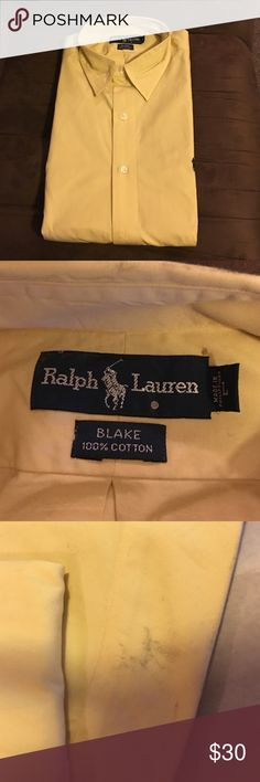Yellow Ralph Lauren Dress Shirt 100% cotton yellow Ralph Lauren dress shirt. Size large. There is a scuff on the back of the shirt that must have happened after being picked up from the dry cleaning. I'm sure it would come out if cleaned again. Freshly pressed & starched. Great shirt at a great price. Ralph Lauren Shirts Dress Shirts