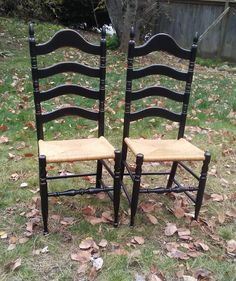 A pair of vintage chairs painted black with beautiful rush seats. https://www.facebook.com/AVintageWren