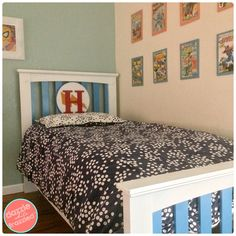 Turn a Craigslist kids wood bed frame into a DIY superhero boys bed using spray paint. Make a DIY wood superhero emblem to sit on the headboard.