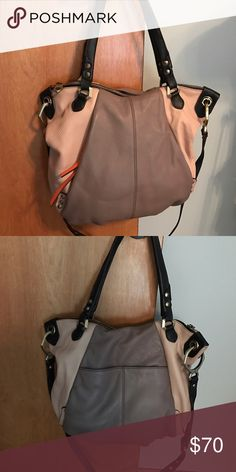 Like new Oryany large leather handbag Large leather Oryany bag purchased new from Qvc. Excellent condition no signs of wear. From smoke free and pet free home. Large bag is approximately 15in wide & 12in tall. Comes with dust bag. Zipped pocket on front of bag with orange zipper pull and outside slip pocket on the back. oryany Bags Satchels
