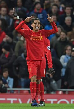 Liverpool's Brazilian midfielder Roberto Firmino celebrates after scoring the opening goal of the English Premier League football match between Liverpool and Arsenal at Anfield in Liverpool, north west England on March 4, 2017.  / AFP PHOTO / Paul ELLIS / RESTRICTED TO EDITORIAL USE. No use with unauthorized audio, video, data, fixture lists, club/league logos or 'live' services. Online in-match use limited to 75 images, no video emulation. No use in betting, games or single…