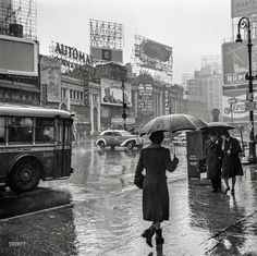 "March 1943. ""New York, New York. Times Square on a rainy day."" Photo by John Vachon for the Office of War Information."