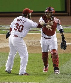 Game 3 of the NLCS -Molina and Motte celebrate another win. 10-17-12