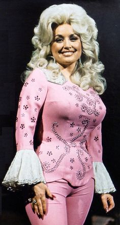 "Dolly Parton. 5'0"". Dolly Rebecca Parton is an American singer-songwriter, actress, author, businesswoman, and humanitarian, known primarily for her work in country music. #DollyParton #Busty #Dolly"