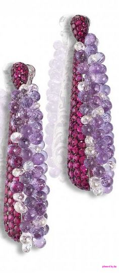 Earrings in white gold set with 259 rubies, 568 white diamonds, 81 amethyst briolettes and 22 white diamond briolettes by de Grisogono