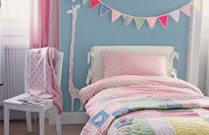 cute bunting idea above bed