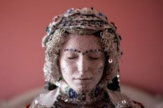 The Kosovan bride is transformed from a girl into a work of art. In the remote village of Donje Ljubinje the young bride is painted alabaster white and decorated with evil eye drawings and geometric lines to ward off bad luck during their wedding ceremony. Painted by the female members of her family, the process is a intimate and deeply meaningful one. After the wedding has taken place and the bride is presented to her husband, the same members of the family remove the make up, preparing her…