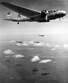 """Splendid shot of a Mitsubishi G3M """"Nell"""" bomber squadron flying in formation in the Pacific. This was the first modern Japanese long range bomber to be produced on a wide scale."""