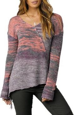 ff55c2b8596 Multicolored yarn paints a modern picture while the asymmetric seaming of  this…