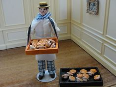 Kim Murdock, IGMA fellow  - hand sculpted pie street vendor carrying a tray of pies. He is dressed in blue and white striped pants with a white shirt and apron. sold on ebay for $59