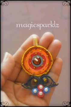 Quilled Pendant http://magicsparklz.blogspot.in/2015/04/quilled-pendant-2.html