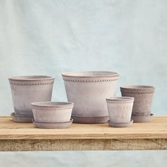 """Topped with sweet scallops, this tapered pot is made from Italian Galestro clay. Taking its name from its home in Copenhagen and the high-fired clay that forms each piece, the Købenler Collection captures the simple beauty of Scandinavian design.- Galestro terracotta clay- Indoor or outdoor use- Drainage hole included- Please note: each pot is hand-finished; some variation in color and texture should be expected. See group photo for variance.- Handmade in ItalySmall: 5.25""""H, 4.75""""D, 5.5""""…"""