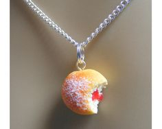 We know what you're thinking – white dress, sugar, jam…they just don't quite go do they? If you're nervous of spilling bright red jam down your gorgeous wedding dress then this doesn't mean you have to miss out on the doughnut fun. We love this cute pendant available from Etsy and think it would look fab with a fun retro style 1950s wedding dress.