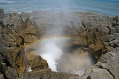 as waves wash against these rocks geysers would shoot out of cracks and holes sometimes forming rainbows