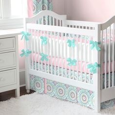 Aqua Haute Baby Crib Bedding | Carousel Designs.  Simple and sweet, our Aqua Haute Baby crib bedding collection will create a nursery that dreams are made of. The exquisite shades of bubblegum pink and teal accent this delightful medallion print. The modern design is perfect to grow right along with your little one.