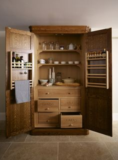 Felsted Showroom | Kitchen Design: Nickleby | The Nickleby design embodies the true spirit of the classic contemporary kitchen. | This is the freestanding smoked oak Cook's Pantry. #humphreymunson #pantry #kitchen #oak #storage #ideas #bespoke #inspiration