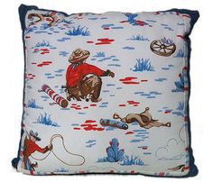 Cowboy cushion Kath Kidson fabric combined with denim and stripes great for boys bedroom. $35.00, via Etsy.