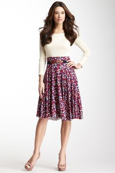 Full colorful printed skirt, neutral plain top or sweater, nude shoes