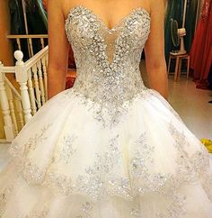 Above is a strapless sweetheart wedding dress with a lot of bling. Description from sangmaestro.com. I searched for this on bing.com/images