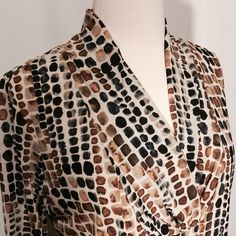 """Tan & Brown Mesh Printed V-neck Blouse Pretty printed mesh blouse. Modern V-neck with pleading details, fully lined front and back. Loose fitting silhouette.   92% poly 8% spandex  lining 100% poly   Machine washable   40"""" bust  26"""" overall length Dana Buchman Tops Tunics"""