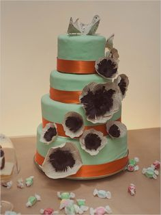 mint wedding cake with paper flowers