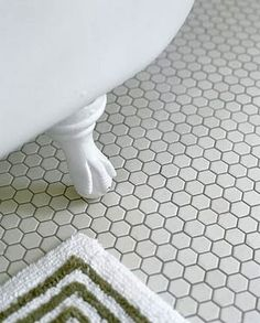 hex tile, clawfoot tub, clean lines and bold color rug
