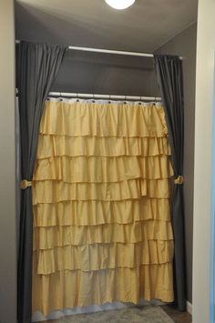 I really like the two side panel idea, and the yellow rosette curtain tie backs. super cute way to jazz up a one color curtain. Ruffle Shower Curtain by jamilyn2210 on Etsy.