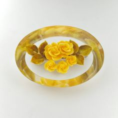 Check out this item in my Etsy shop https://www.etsy.com/listing/494613973/yellow-rose-pin-reverse-carved-lucite