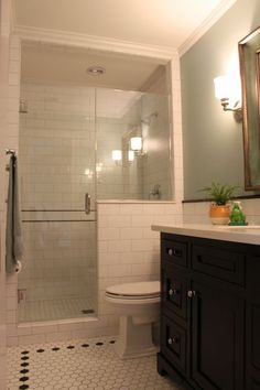 Traditional 3/4 Bathroom with Undermount Sink, Wall sconce, Quartz countertop, Inset cabinets, penny tile floors, Subway Tile