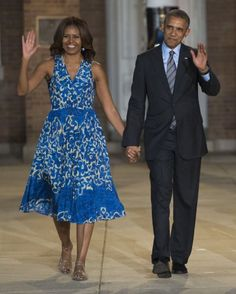 Attending the Marine Barracks Evening Parade with her husband, wearing summery bright blue.