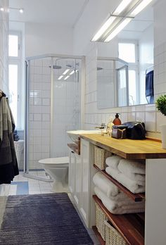 bathroom idea - sink on laundry room wall and counter/cubbard under window, glass door on shower.