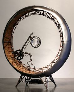 Gregory Brotherton clever modernist mixed media metal wirework artwork sculpture man on the wheel ,clever image of the monotony of worklife being on the treadmill...reminds me of prometheus and the rock
