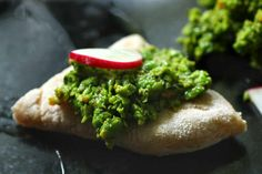 Sweet Pea Guacamole and radish on pita bread