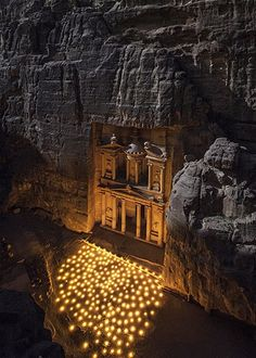 Feb. 22, 2013: Hundreds of candles light up 'The Treasury,' an ancient, 150-foot temple in Petra, Jordan. (© Andrew Waddington/Solent News & Photo Agency)