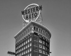 This is a black and white photo of the sign for the historic Western Auto building in Kansas City, Missouri. The image is printed on professional, acid free, archival satin paper giving the image rich and vibrant colors. Prints are packaged in acid-free, moisture resistant sleeves, and shipped in rigid cardboard mailers. Please note that the watermark will not appear on the final product.  Print sizes available include:  5 x 7 8 x 10 11 x 14 16 x 20 24 x 30