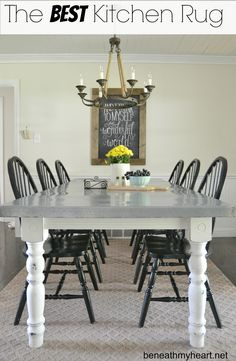 I wouldn't do a rug in my kitchen - messy kids. But I love the table and wall color.