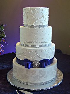 Elegant White Damask Wedding Cake. I love, plus you could change ribbon color based on scheme.