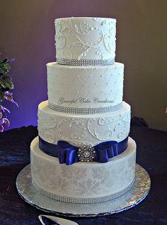 Elegant White Damask Wedding Cake. I love, plus you could change ribbon color based on scheme. wedding elegant cakes, ribbon color, wedding cake damask, blue cakes, damask wedding cake, white cakes, elegant white wedding cakes, chang ribbon