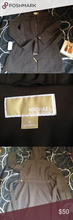 "Chocolate brown belted MICHAEL Kors jacket coat M MICHAEL  Michael kors  BRAND, Excellent condition,medium,brown color with gold tone logo hardware,nice soft fleece type interior for fall/winter, outside is a rain/weather resistant type material ,hardware has scratches that do not affect the coat in any way,0utside is flawless , I see one ""spot"" that I havent tried to remove inside the lapel,a bit longer length trench type would be cute with boots and jeans or even dresses MICHAEL Michael…"