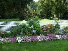 Garden along the fence Photography at ArtistRising.com  this is how i imagine my own border garden to look like... maybe pentunias along the sunny side and impatiens on the shady side...