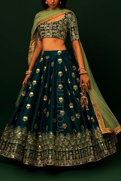 Greek Blue Jade Embroidered Lehenga Price: INR 7990 Dazzle this festive season with this unusual combination of embroideries – sure to make you stand out! Greek Blue lehenga with kalira embro… Indian Bridal Outfits, Indian Bridal Fashion, Indian Designer Outfits, Designer Dresses, Indian Designers, Wedding Outfits, Indian Skirt, Dress Indian Style, Indian Dresses