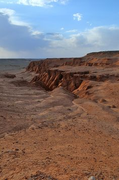Bayanzag Flaming Cliffs in the Gobi Desert, Mongolia. Join us for some camel- and horse-riding here with nomads. www.TheTripStudio.com