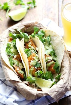 Crispy Fish Tacos with Jalapeño Sauce by pinchofyum Lightly battered and fried fish served with a fresh, spicy homemade sauce! simple and delicious.  #Tacos #Fish #Jalapeno
