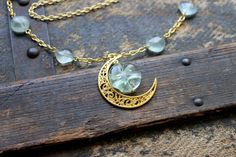 Fluorite and the Bright Gold Crescent Moon Necklace by earthcharms on Etsy