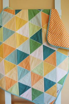 GEOMETRIC Quilt. I love the colors. I want this in a bigger size.